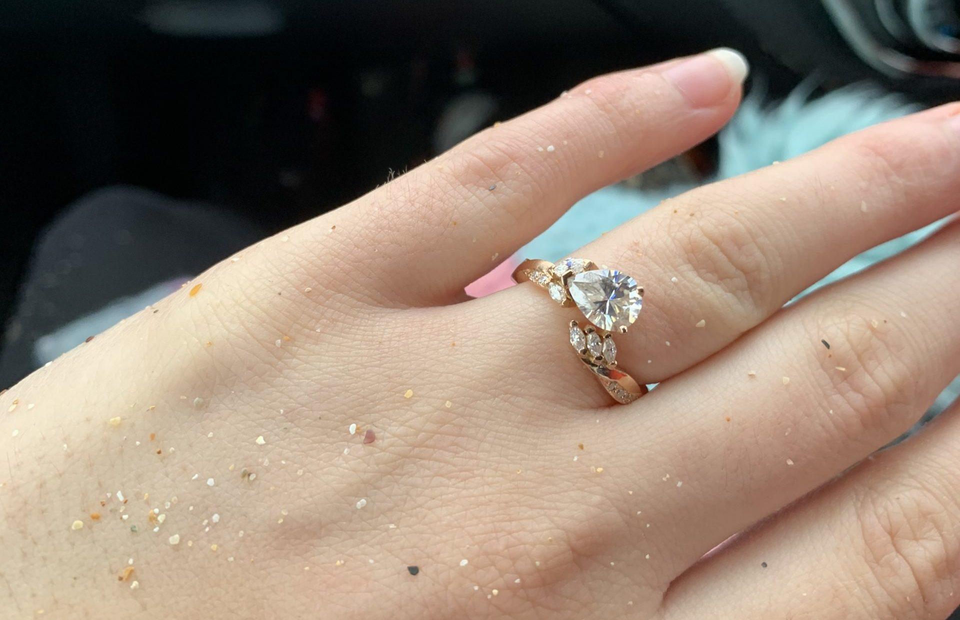 The bespoke ring on Nikki's sandy hand