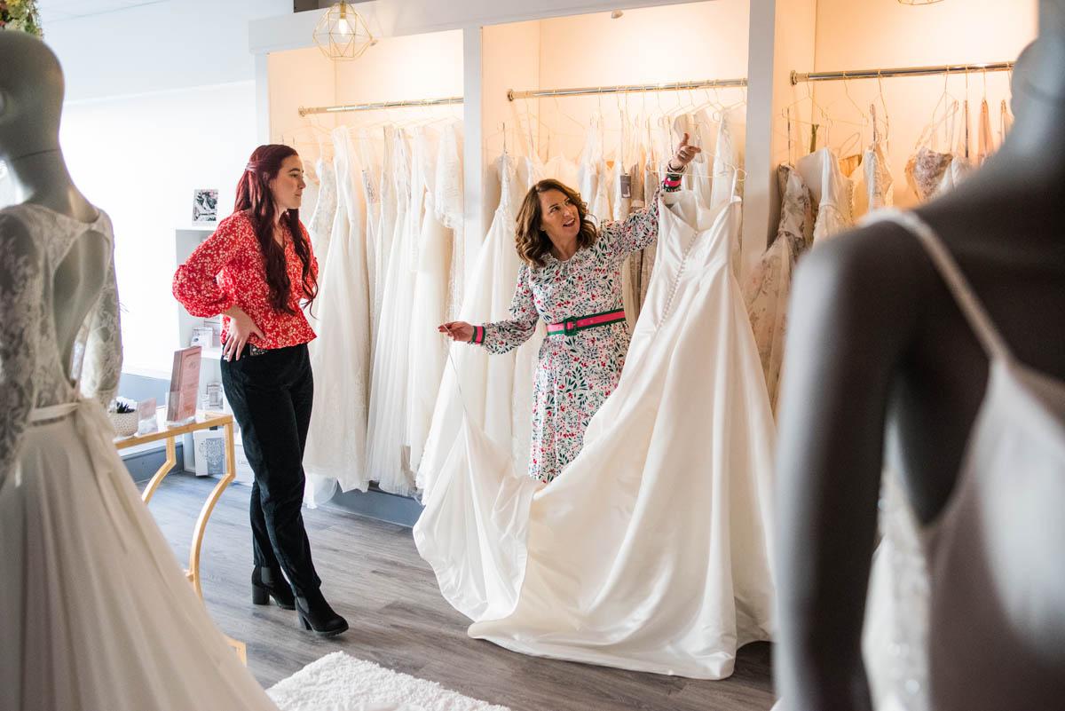 Tara shows a wedding dress to a potential customer at Bridal Studio in Helston, Cornwall